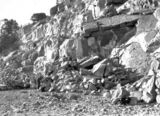 Picture relating to Mugga Quarry - titled 'Mugga Quarry face with quarry man'