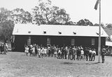 Picture relating to Russell - titled 'Opening of Mt Russell School, Canberra. Building was relocated from Ainslie.'