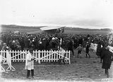 Picture relating to Duntroon - titled 'Kingsford Smith's Fokker Trimotor type FV111 B/3M aircraft, Southern Cross and crowd at the air force landing ground near Duntroon (now Fairburn).'