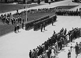 Picture of / about 'Parliament House' the Australian Capital Territory - Armistice Day Ceremony with the Royal Military College Cadets on parade in front of Old Parliament House. Inspection by Prime Minister Scullin.