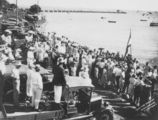 Picture relating to Redcliffe - titled 'Crowds gathering to watch rowing near the Woody Point jetty, ca. 1935'