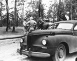Picture relating to Strathpine - titled 'General Douglas MacArthur standing with five other soldiers at Camp Strathpine, 1944'