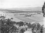 Picture relating to Ainslie - titled 'View from Mt Ainslie showing Anzac Parade, St John's Church, Old Parliament House, Hotel Canberra, Commonwealth Bridge and Scotts Crossing.'
