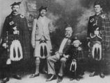 Picture relating to Warwick - titled 'Portrait of members of the Warwick Caledonian Society, dressed in their tartan kilts, in 1903'