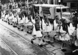 Picture relating to Brisbane - titled 'Soldiers in Greek national dress marching in Brisbane, ca. 1941'
