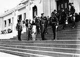 Picture relating to Parliament House - titled 'Governor General, Lord Stonehaven, and his party meeing senior Service officers on the steps of Old Parliament House for the opening of the 12th Parliament.'