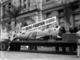 Picture relating to Brisbane - titled 'Remains of a Japanese Zero Fighter aeroplane, shot down by the U.S. Air Force, on display in a Brisbane march, July 1943'