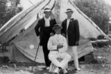 Picture relating to Queensland - titled 'Three young men posing in front of a tent, 1910-1920'