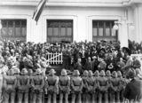 Picture relating to Parliament House - titled 'Presentation of cheque and cigarette case to Bert Hinkler by Prime Minister S. M. Bruce in front of Old Parliament House with Royal Military College Cadets and spectators.'