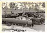 Picture relating to Bogantungan - titled 'Midlander train wreck, Medway Creek, 1960'