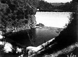 Picture relating to Cotter Dam - titled 'Cotter Dam wall, spillway and stilling pool.'