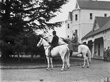 Picture relating to Yarralumla - titled 'Lord Stonehaven and his wife on horseback [ Lady Stonehaven is riding side saddle] at Government House, Yarralumla.'