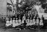 Picture relating to Stafford - titled 'Group of children dressed up for a patriotic concert at Stafford State School, Brisbane, 1915'