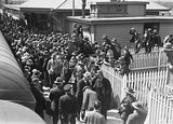 Picture relating to Canberra - titled 'Arrival of Mr J. H. Scullin newly elected Prime Minister at Canberra railway station with welcoming crowds.'