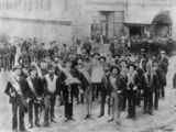 Picture relating to Brisbane - titled 'Group of men gathered outside the Protestant Hall, Brisbane, Queensland, 1889'
