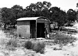 Picture of / about 'State Circle' the Australian Capital Territory - The Surveyors hut on State Circle - Originally Federal Capital Survey Camp established in 1909. It is one of the oldest Commonwealth buildings in the ACT. Charles Robert Scrivener, surveyor, used this hut for secure storage of survey documents.