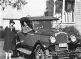 Picture relating to Acton - titled 'Mrs Adele Mildenhall and Mr Ivo Smith in his Pontiac roadster. Acton.'