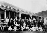 Picture relating to South Brisbane - titled 'Freeleagus family in front of a house in Stanley Street, South Brisbane, ca. 1925'