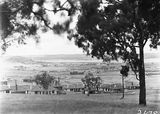 Picture relating to Kingston - titled 'View from Forrest over Kingston to Duntroon showing Hotel Wellington and Telopea Park School'