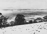 Picture relating to Red Hill - titled 'Snow fall - View from Red Hill over Collins Park, Manuka and Kingston to Duntroon .'