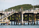 Picture relating to Coffs Harbour - titled ' Youths using jetty'