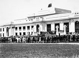 Picture relating to Parkes - titled 'Armistice Day Ceremony with the Royal Military College Cadets on parade in front of Old Parliament House with spectators. View from Parkes Place.'