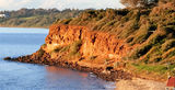 Picture relating to Mornington - titled 'Red Cliff at sunset Mornington beach'