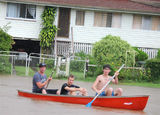 Picture of / about 'Grantham' Queensland - Boys having fun canoeing the streets of Grantham