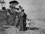 Picture relating to King Island - titled 'Woman and two children on the foreshore of King Island, Queensland, 1890-1900'