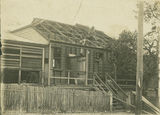 Picture relating to Innisfail - titled 'Repairing the roof of the Innisfail Post Office after the cyclone'