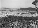 Picture relating to Braddon - titled 'Reid, Braddon and Civic Centre from Mt Ainslie. Ainslie Hotel, Limestone Avenue on right, Black Mountain at the rear.'