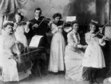 Picture relating to Mount Morgan - titled 'Portrait of the Foster family playing musical instruments at Mount Morgan, Queensland, 1914'