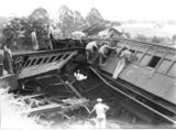 Picture relating to Camp Mountain - titled 'Relief workers inspect smashed carriages after railway accident at Camp Mountain, Queensland, 1947'